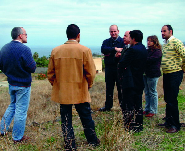 Members of the local and island administrations inspect the site