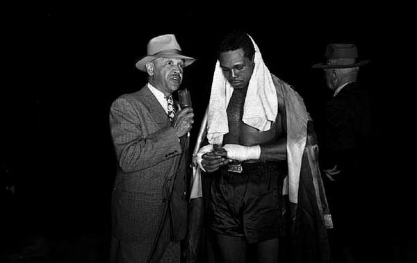 Archie Moore being interviewed