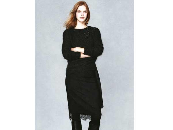 Spiel mit Kontrasten. Die klassische Winterfarbe Schwarz hat Vanessa Bruno für das Label La Redoute spannend umgesetzt: Zum weichen Pulli mit asymmetrischen Glanzeffekten ein schmaler Rock mit raffinierter Spitze.